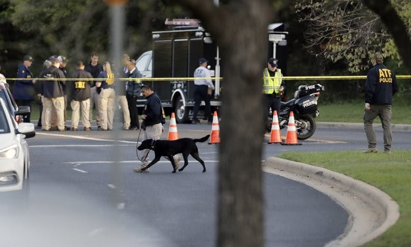 Officials work and stage near the site of Sunday's deadly explosion, Monday, March 19, 2018, in Austin, Texas. Police warned nearby residents to remain indoors overnight as investigators looked for possible links to other package bombings elsewhere in the city this month. Associated Press
