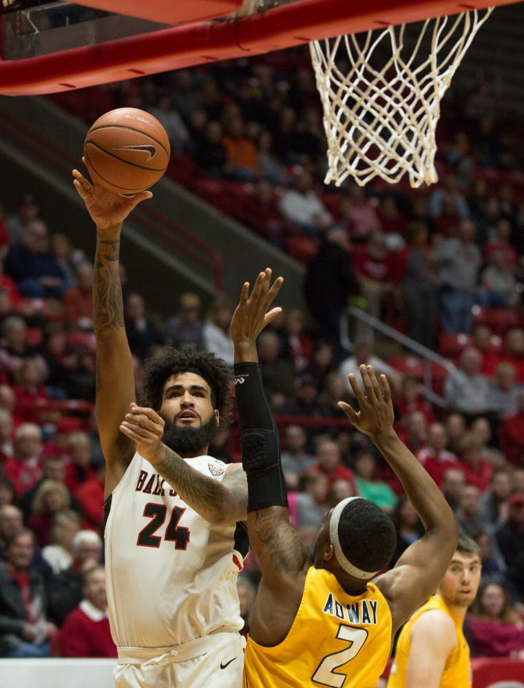 Junior Trey Moses goes in for a basket durring the first half of the against Toledo, OH. The cardinals were able to score 10 points before the Toledo rockets made a point. Worthen Arena, Feb. 17. Eric Pritchett, DN
