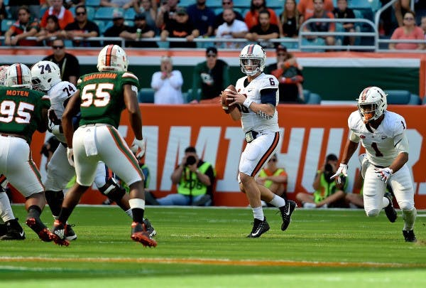 Rosier helps No. 3 Miami survive scare from Virginia