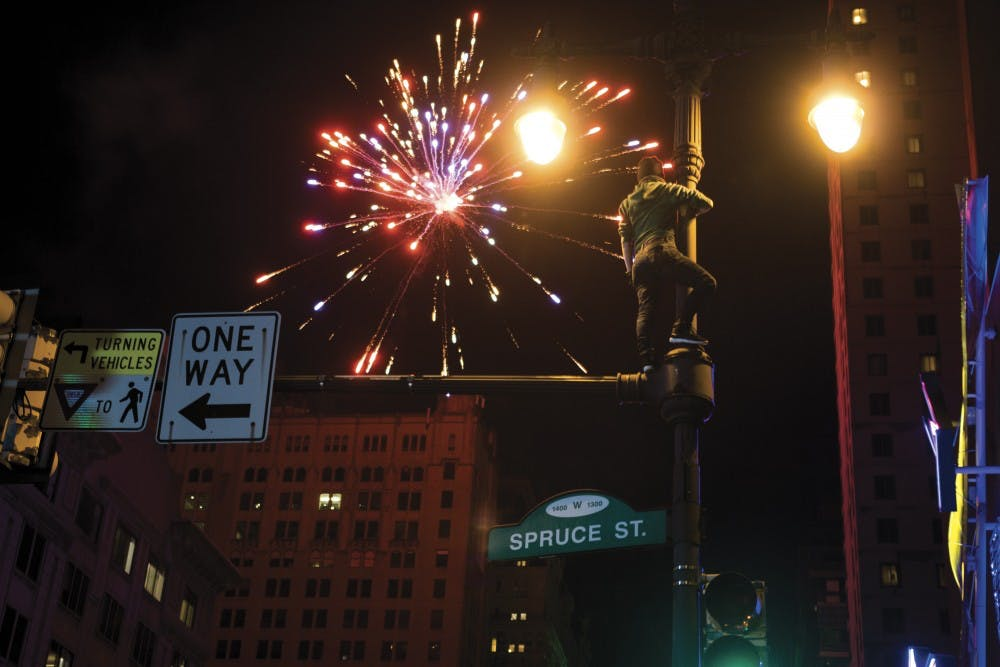 Fan on pole and fireworks