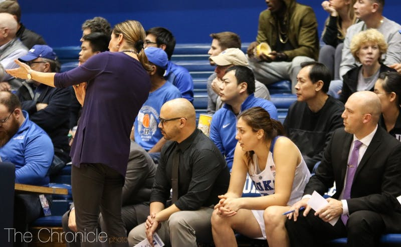 Limin Xu sat behind the Duke bench and observed practices for three weeks in January.
