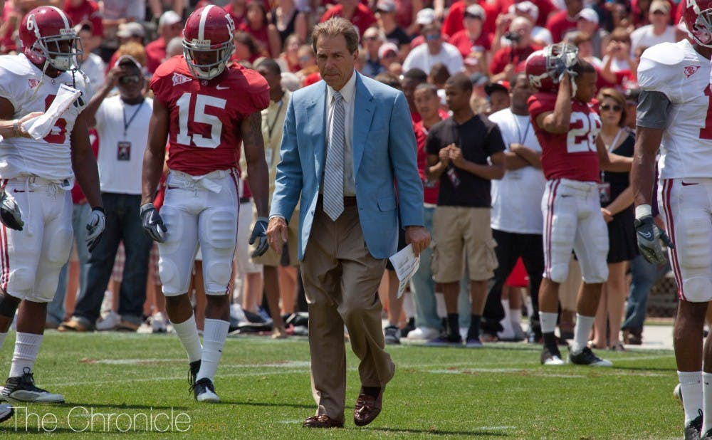 A-Day_Game_football_scrimmage_for_University_of_Alabama,_with_coach_Nick_Saban_analyzing_every_move.