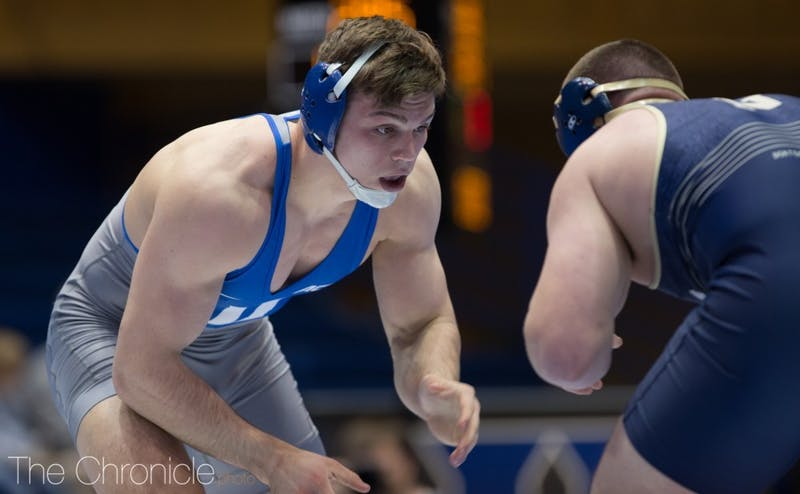 Jacob Kasper's win decided the team match on Senior Day at Cameron Indoor Stadium.