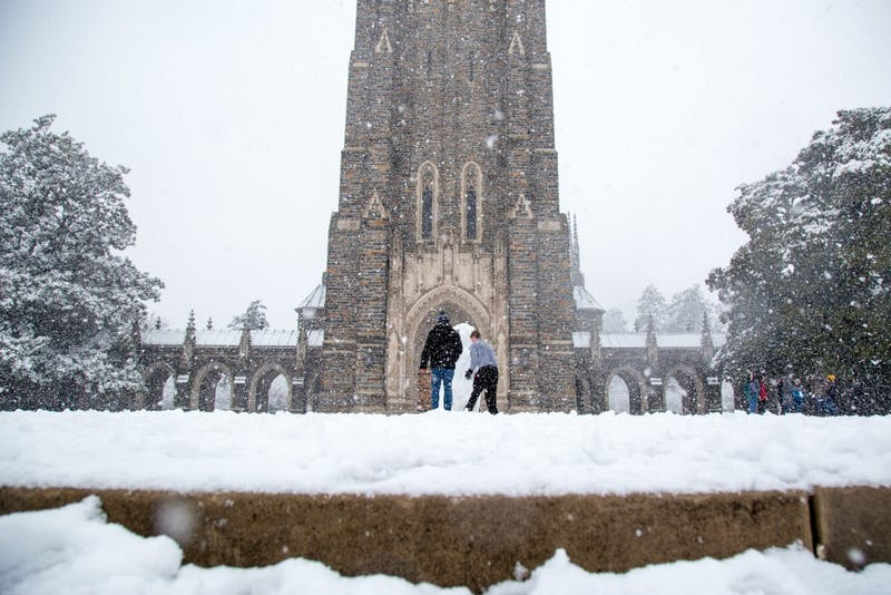 Sophomores Josh Young and Ameen Ahmad build a snowman in front of the chapel. Photo by Charles York