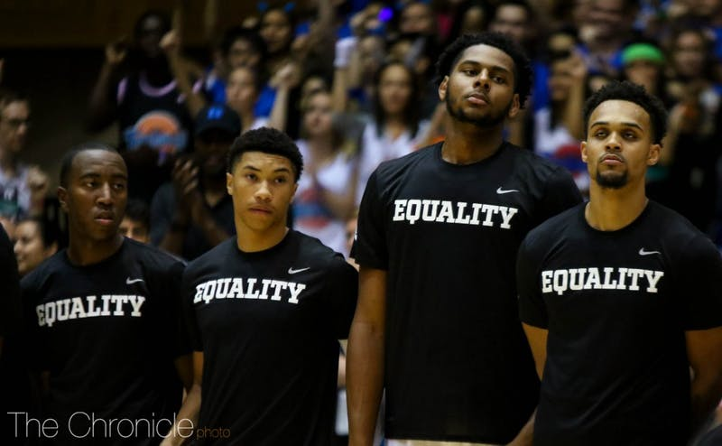 """The Blue Devils donned shirts with the word """"Equality"""" when they came out of the locker room just before tip-off."""