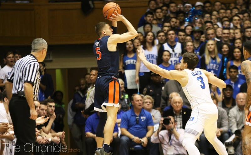 Kyle Guy knocked down a late 3-pointer after Virginia got two offensive rebounds on a key possession.