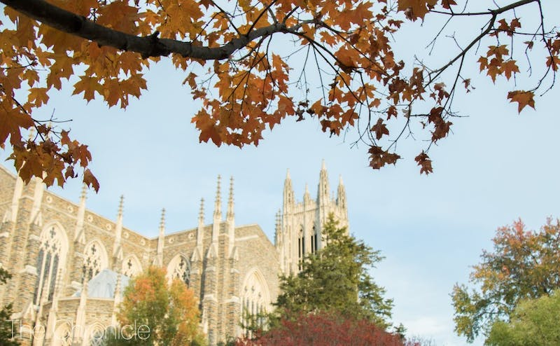 Colorful leaves frame the Duke Chapel on a chilly fall day.