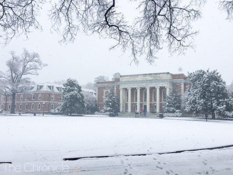 Snow covers the East Campus quad in front of Marketplace.
