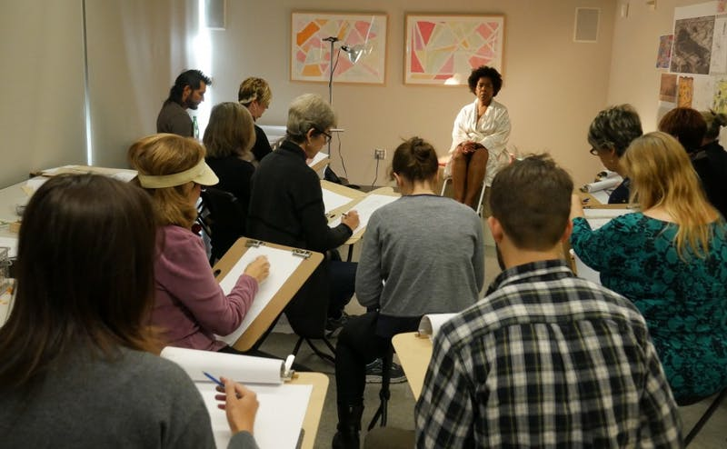 Artists gather in a classroom for the last of three sessions in this month's Nasher Creates Sketching Series, which centered around the Carlo Dolci exhibit.
