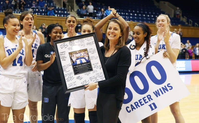 Joanne P. McCallie spoke at a brief postgame ceremony following her 600th career win Friday.