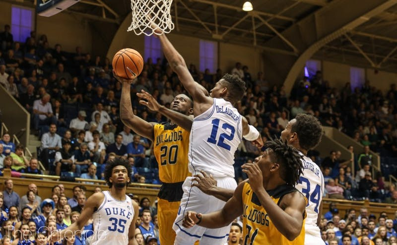 Javin DeLaurier, Marvin Bagley III and Wendell Carter Jr. formed a formidable defensive group on the baseline of a 2-3 zone.