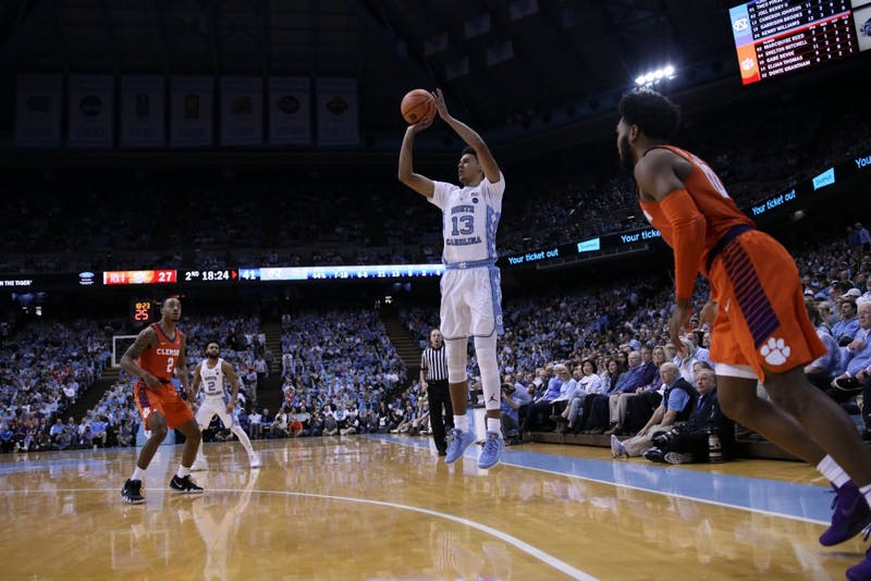 Cameron Johnson (13) shoots a 3-pointer against Clemson on Jan. 16 in the Smith Center.