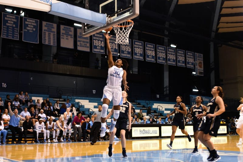 Forward Jaelynn Murray (30) scores against Wingate on Wednesday night in Carmichael Arena.
