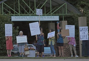 A number of local activists took to the sidewalks outside of Chapel Hill Town Hall on the evening of Thursday, August 24th, to protest the OWASA board's continued fluoridation of Orange County water sources.