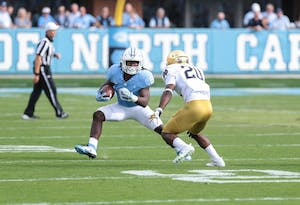 Running back Michael Carter (8) makes a cut against Notre Dame on Oct. 7 in Kenan Memorial Stadium.