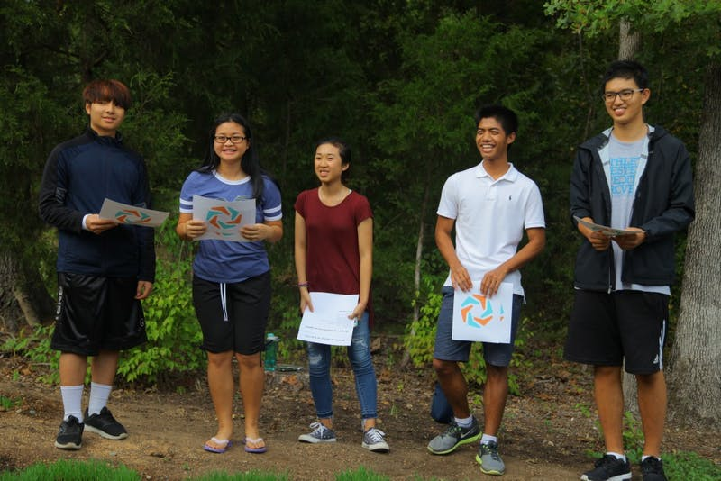 Teens from the Refugee Community Partnership perform a poem at the Botanical Garden Sculpture Show on Saturday September 16.