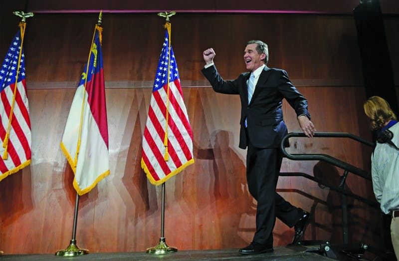 Governor Roy Cooper crosses the stage to deliver his victory speech on Dec. 6, 2016 in Raleigh, NC.