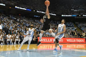 Wofford guard Fletcher Magee (3) finishes a left-handed layup against North Carolina on Dec. 21 in the Smith Center.