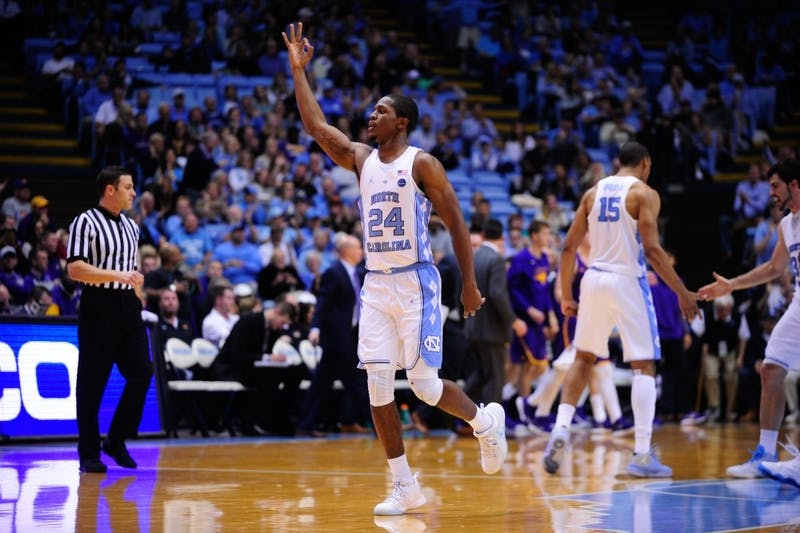 Guard Kenny Williams (24) celebrates a 3-pointer against Northern Iowa on Friday in the Smith Center.