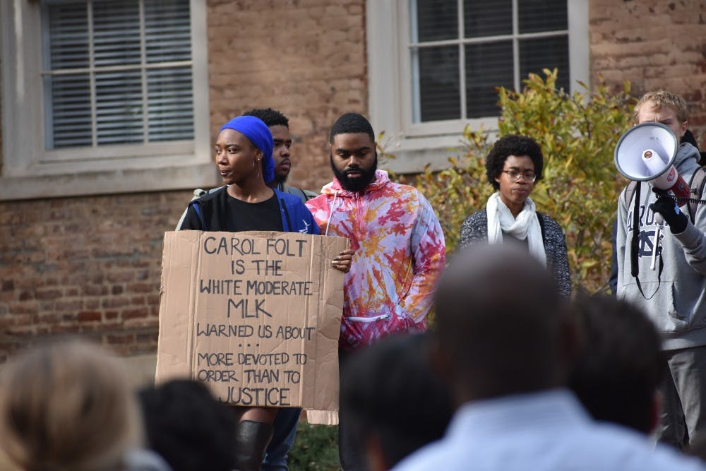 Hand in hand, protesters once again call for removal of Confederate statue