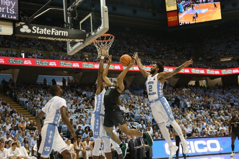 Guard Joel Berry (2) blocks a shot against Tulane on Dec. 3 in the Smith Center.