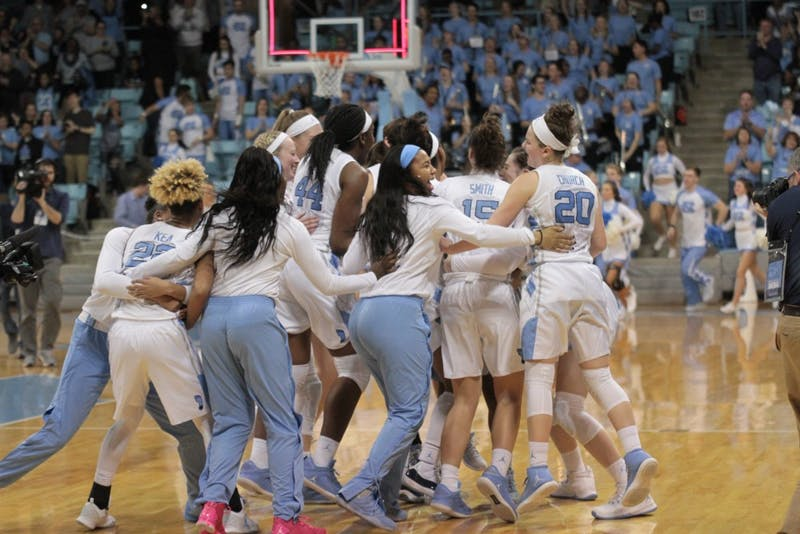 The UNC women's basketball team celebrates its win over Duke, 92-86, in overtime on Jan. 21 in Carmichael Arena.