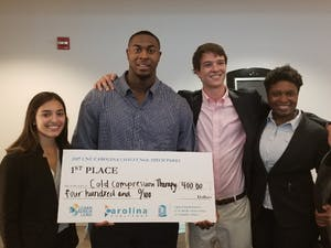 Winning team of Carolina Pitch Party poses with award money. Photo courtesy of William Sweet.