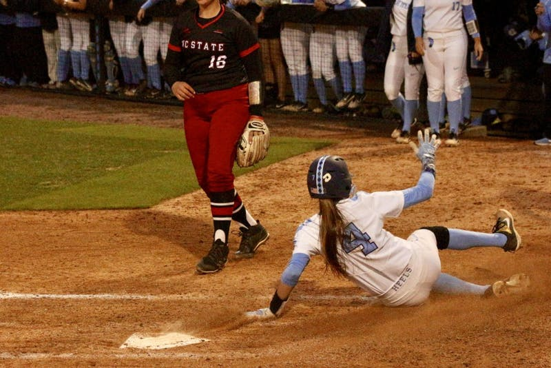 Junior Leah Murray (4) slides into home against N.C. State on April 16 in Anderson Stadium.
