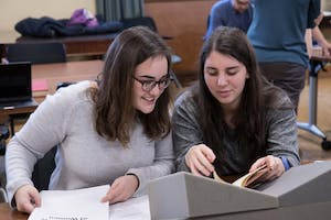 """Blythe Gulley and Caroline Alessandro are in UNC Professor Jeanne Moskal's English class that will present """"Reconstructing Frankenstein's Monster: Mary Shelley's World in Print"""" on Thursday in Wilson Library. Photo by Aleah Howell."""