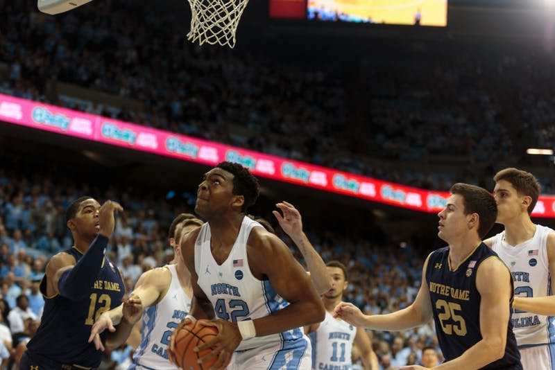 Brandon Huffman (42) looks up at the basket in the closing seconds of UNC's 83-66 win over Notre Dame on Feb. 12 in the Smith Center.