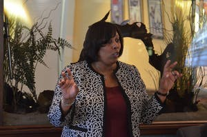 Dr. Ingrid McCree, the athletic director at North Carolina Central, speaks with members of the Chapel Hill Sports Club at Squid's Restaurant on March 21.