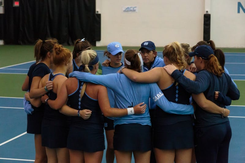 The Women's Tennis team huddles after losing to Georgia Tech on Saturday.