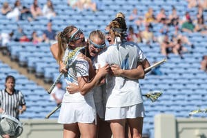 The North Carolina women's lacrosse team celebrates a goal against Duke on April 21 at Kenan Stadium.