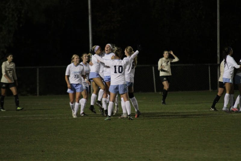 The North Carolina women's soccer team celebrates its 1-0 win over Colorado in the second round of the NCAA Tournament on Friday night at WakeMed Soccer Park in Cary.