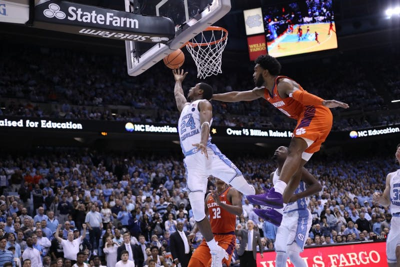 Guard Kenny Williams (24) takes a reverse layup against Clemson on Jan. 16 in the Smith Center.