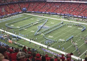 The UNC marching band, The Marching Tar Heels, performs at the Chick-fil-A kickoff game against Georgia in Atlanta on Sep. 3. Photo Courtesy of Kristie Thompson.