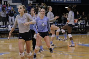 Members of the UNC volleyball team celebrate after their 3-2 win over Georgia Tech on Thursday evening.