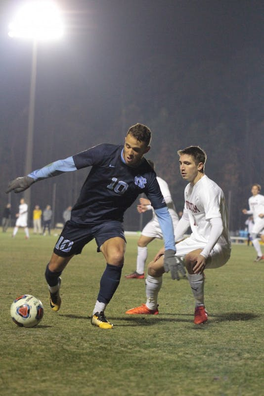 Forward Zach Wright (10) around a Fordham defender on Dec. 2 at WakeMed Soccer Park in Cary.