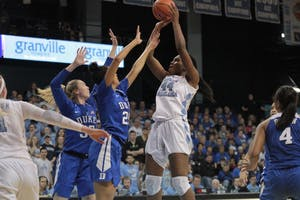 Center Janelle Bailey (44) takes a jumper against Duke on Jan. 21 in Carmichael Arena.