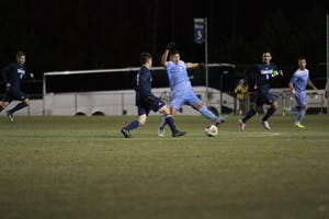 Defender Mauricio Pineda (2) attempts to block a pass against UNC-Wilmington on Sunday night at WakeMed Soccer Park in Cary.