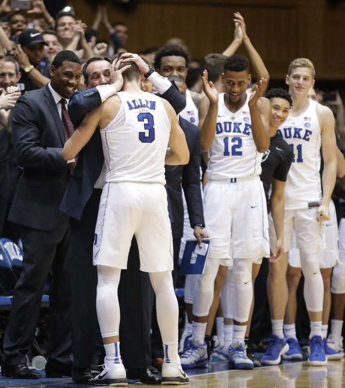 Duke head coach Mike Krzyzewski embraces senior guard Grayson Allen (3) after Allen played his final game at Cameron Indoor Stadium on March 3.