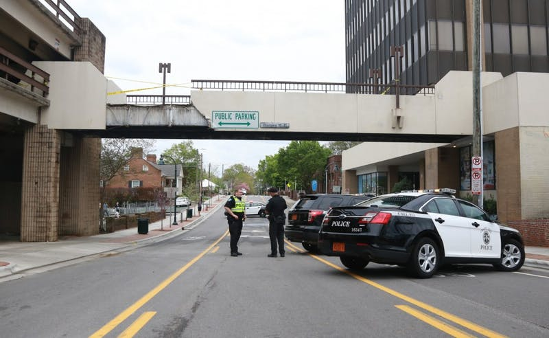 The bridge over East Rosemary that connects the CVS building and the Bank of America Parking Deck collapsed Sunday afternoon.