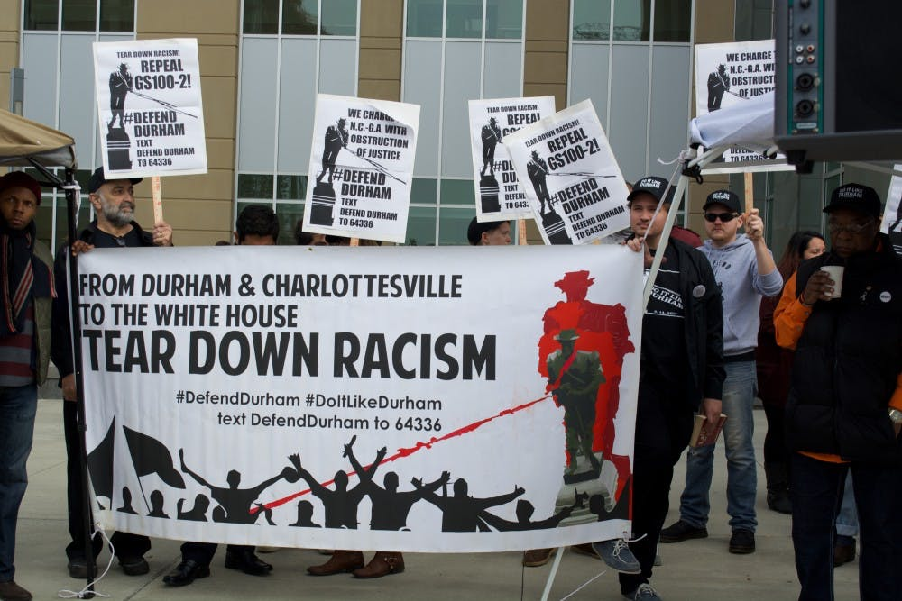 Durham DA drops felony charges against protesters accused of toppling Confederate statue