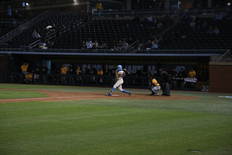 Junior Kyle Datres (3) swings against Appalachian State on April 10 at Boshamer Stadium.