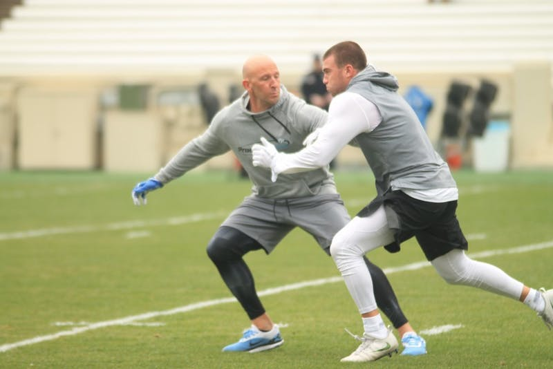 Austin Proehl runs routes while his father Ricky defends at North Carolina football's pro timing day on April 3 in Kenan Stadium.