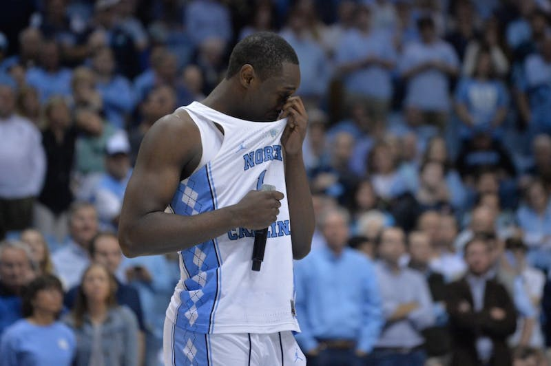Senior Theo Pinson (1) wipes tears from his face during his senior night speech after the game against Miami on Feb. 27 at the Smith Center.