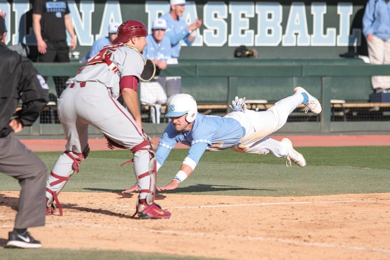 Senior Zack Gahagan (10) dives into home plate against Florida State on March 23.