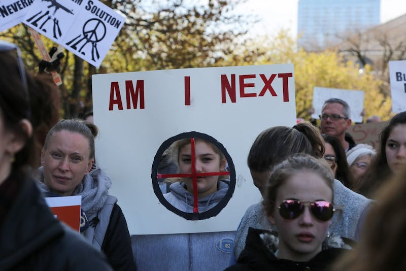 """Caroline Porter, a student at Margaret B Pollard Middle School, holds up a sign saying """"Am I Next"""" at the March for Our Lives rally in Raleigh on Saturday."""
