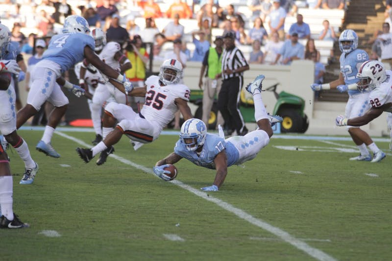 Wide receiver Anthony Ratliff-Williams (17) is tackled against Virginia on Saturday.