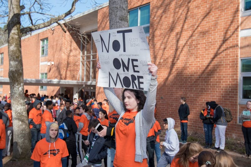 Photo courtesy of Chapel Hill High School student Jonas Todd. Chapel Hill High School student Violet Crain is pictured here participating in the national school walkout protesting gun violence.